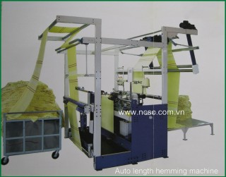 Auto length hemming machine